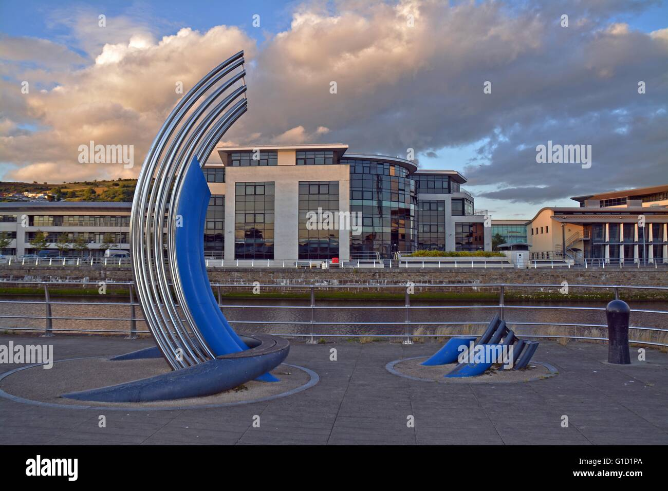 Public Artwork in Swansea, SA1 development is just behind, over the river Twe. - Stock Image