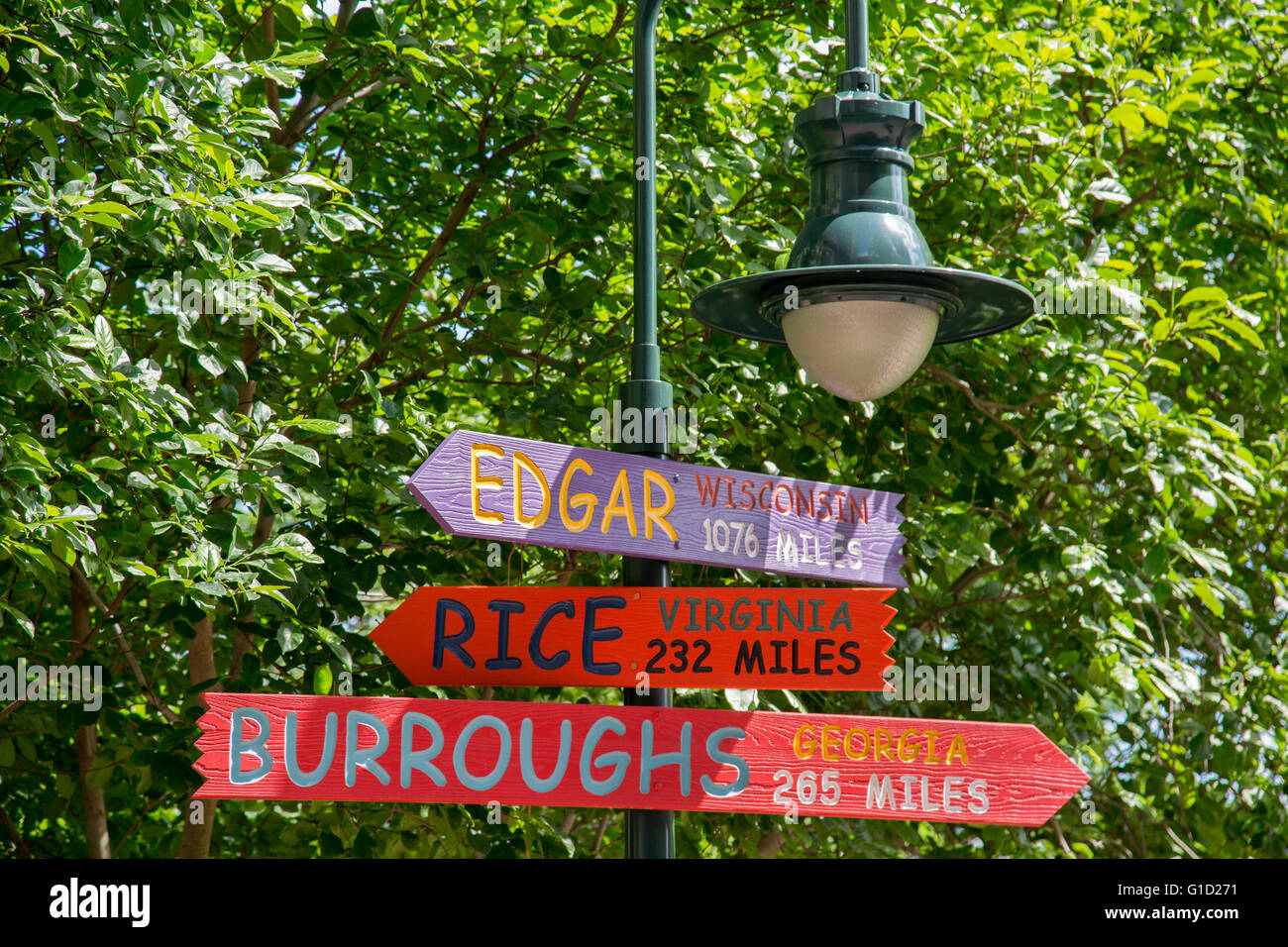 Charlotte, North Carolina - Signs in a city park point to other cities spelling out the name of the writer Edgar - Stock Image