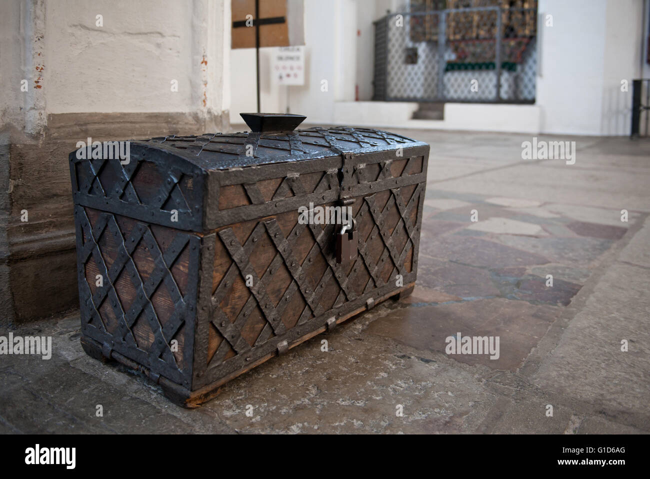Antique large trunk from 1539 in aisle of St. Marys Church, Kosciol Mariacki in Gdansk, Poland, Europe, sightseeing. - Stock Image