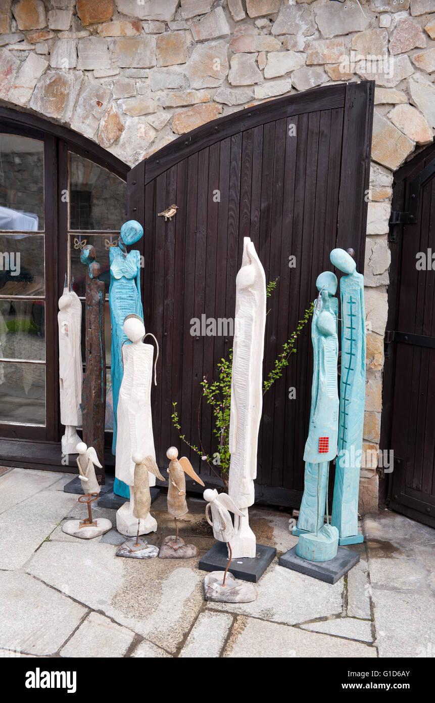 Wooden souvenir sculptures in shop exterior in Kazimierz Dolny, Poland, Europe, bohemian tourist travel destination, - Stock Image