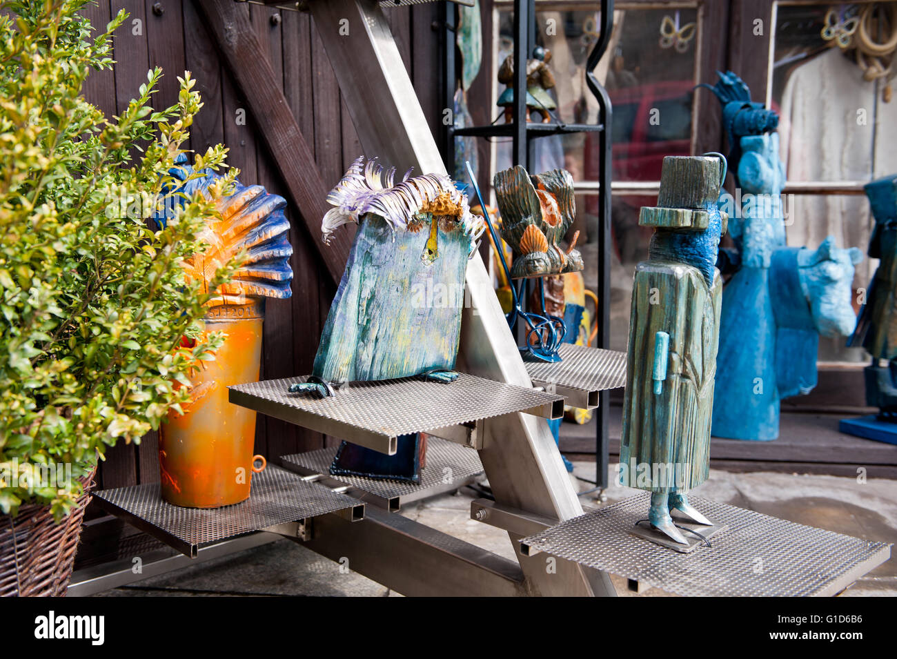 Wooden carved funny art figures in shop exterior in Kazimierz Dolny, Poland, Europe, bohemian tourist travel destination, - Stock Image