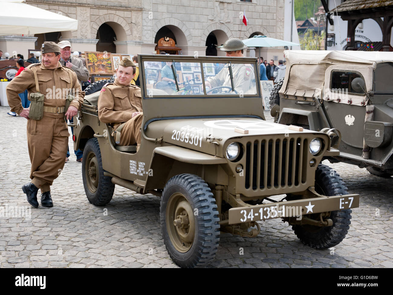 Soldiers reenactors at Rally VI military vehicles from World War II in Kazimierz Dolny, Poland, antique army Willys - Stock Image