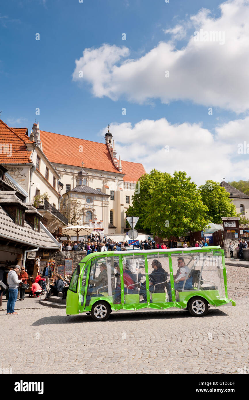 Excursion passenger melex tour at Market square in Kazimierz Dolny, Poland, Europe, electric green car vehicle with - Stock Image