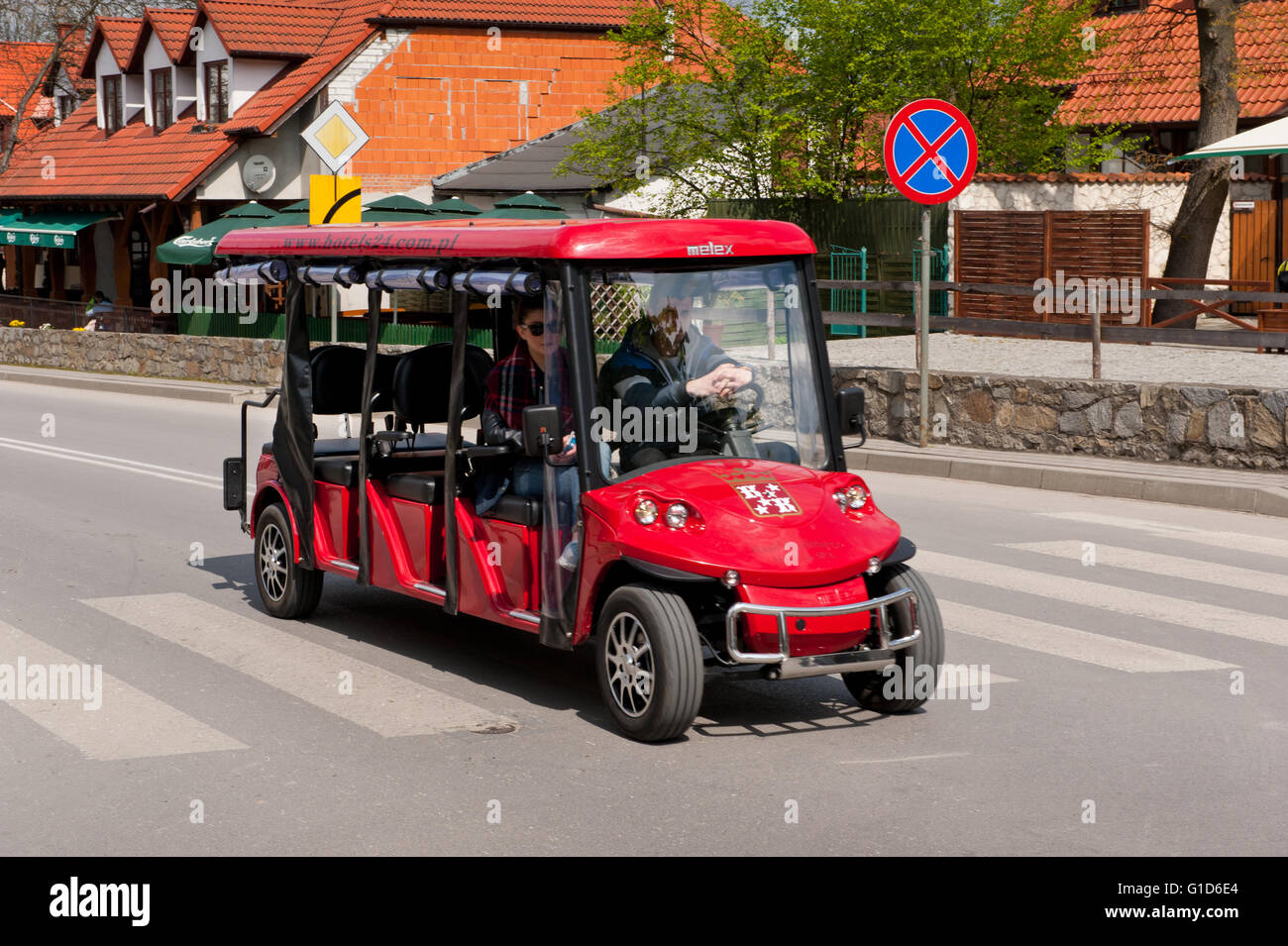 Excursion passenger red melex in Kazimierz Dolny, Poland, Europe, electric car vehicle with passenger taking a short - Stock Image