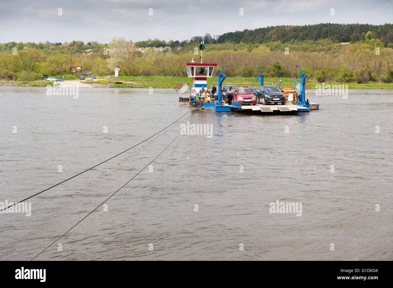 Cable ferry ship floating, course to Kazimierz Dolny from Janowiec in Poland, Europe, passenger local floating bridge. - Stock Image