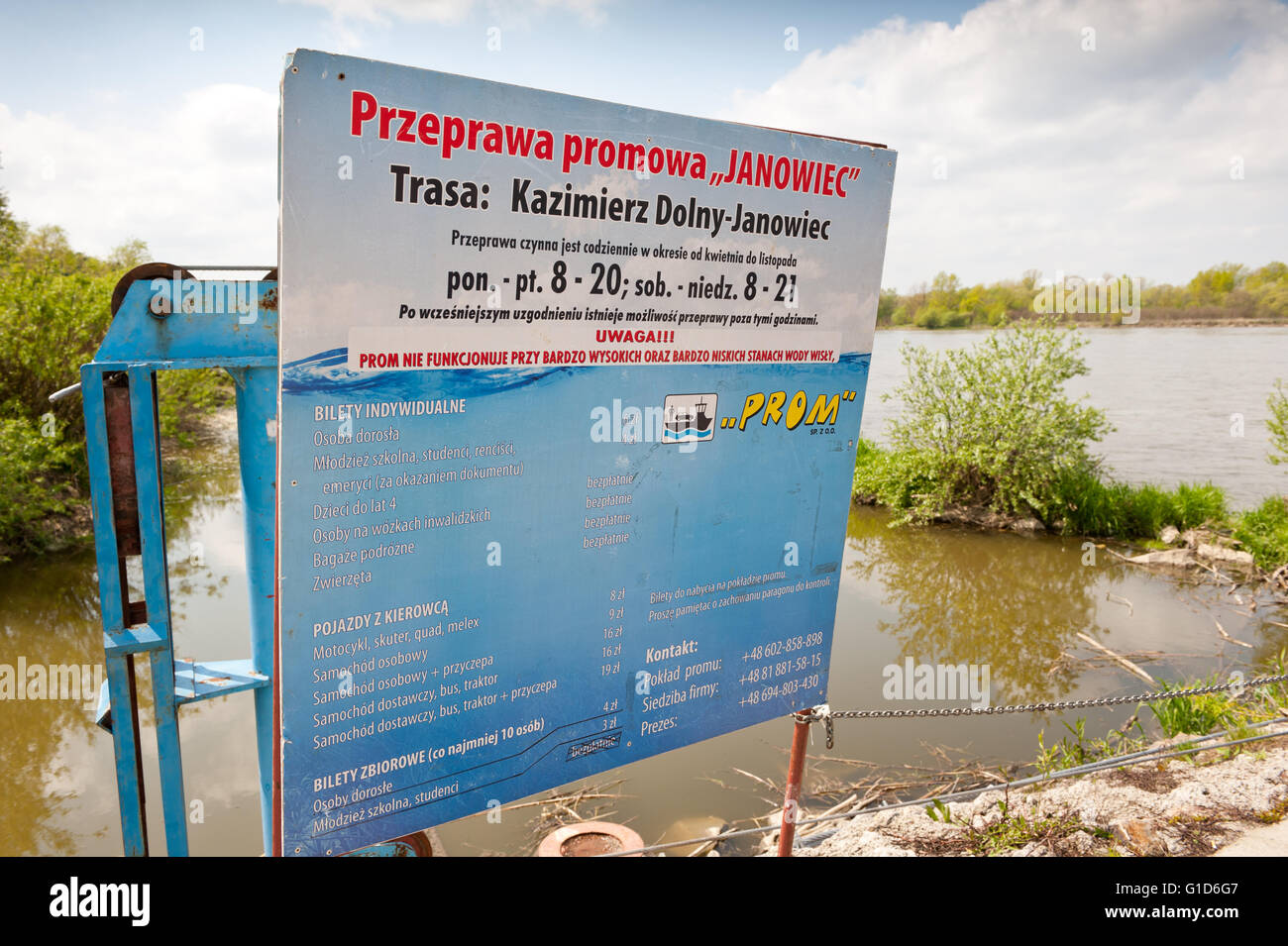Ferry ship crossing information board with work schedule and prices, course from Kazimierz Dolny to Janowiec in - Stock Image