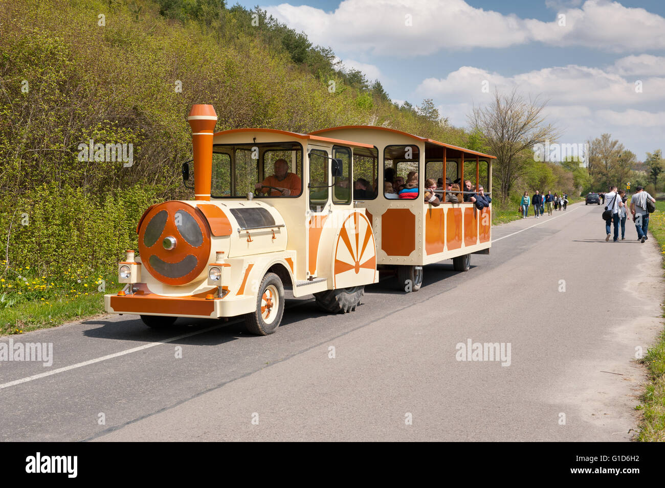 Excursion tractor train tour to Janowiec near Kazimierz Dolny, Poland, Europe, local locomotive vehicle imitation - Stock Image