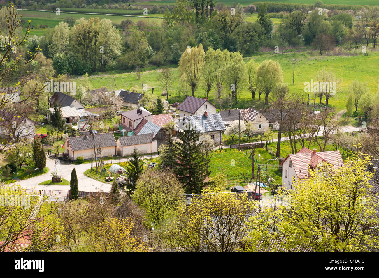 Village landscape view from Janowiec Castle hillside, aerial calming rural scenery and active leisure on May day - Stock Image