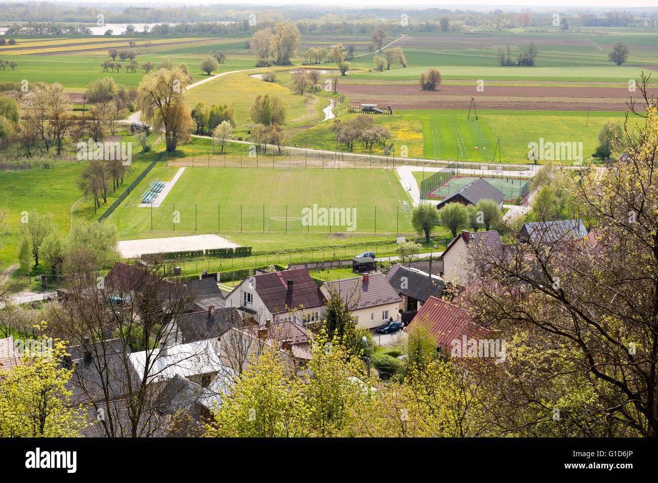 Janowiec village aerial view from castle hillside, calming rural scenery with spring green nature landscape and - Stock Image