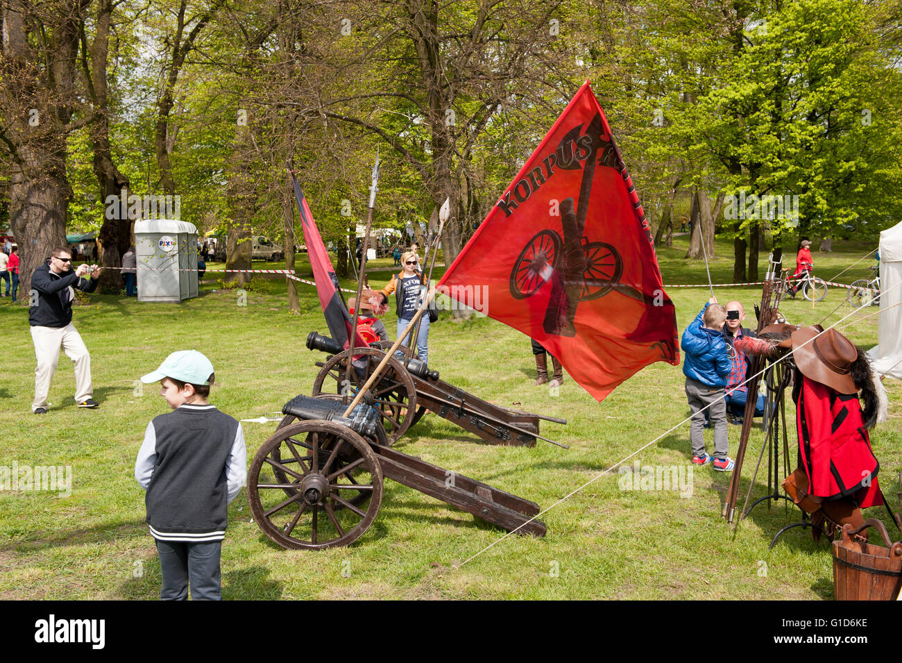 Small cannons at Swedes invasion reenactment picnic in Janowiec Castle, guns with red flags at Swedish assault improvisation. - Stock Image