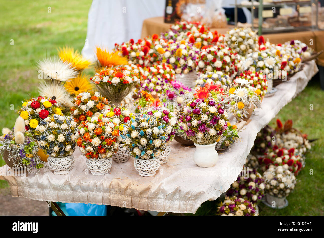 Dry flowers arrangements at fair on May day picnic in Janowiec Castle in Poland, leisure during Swedes invasion - Stock Image