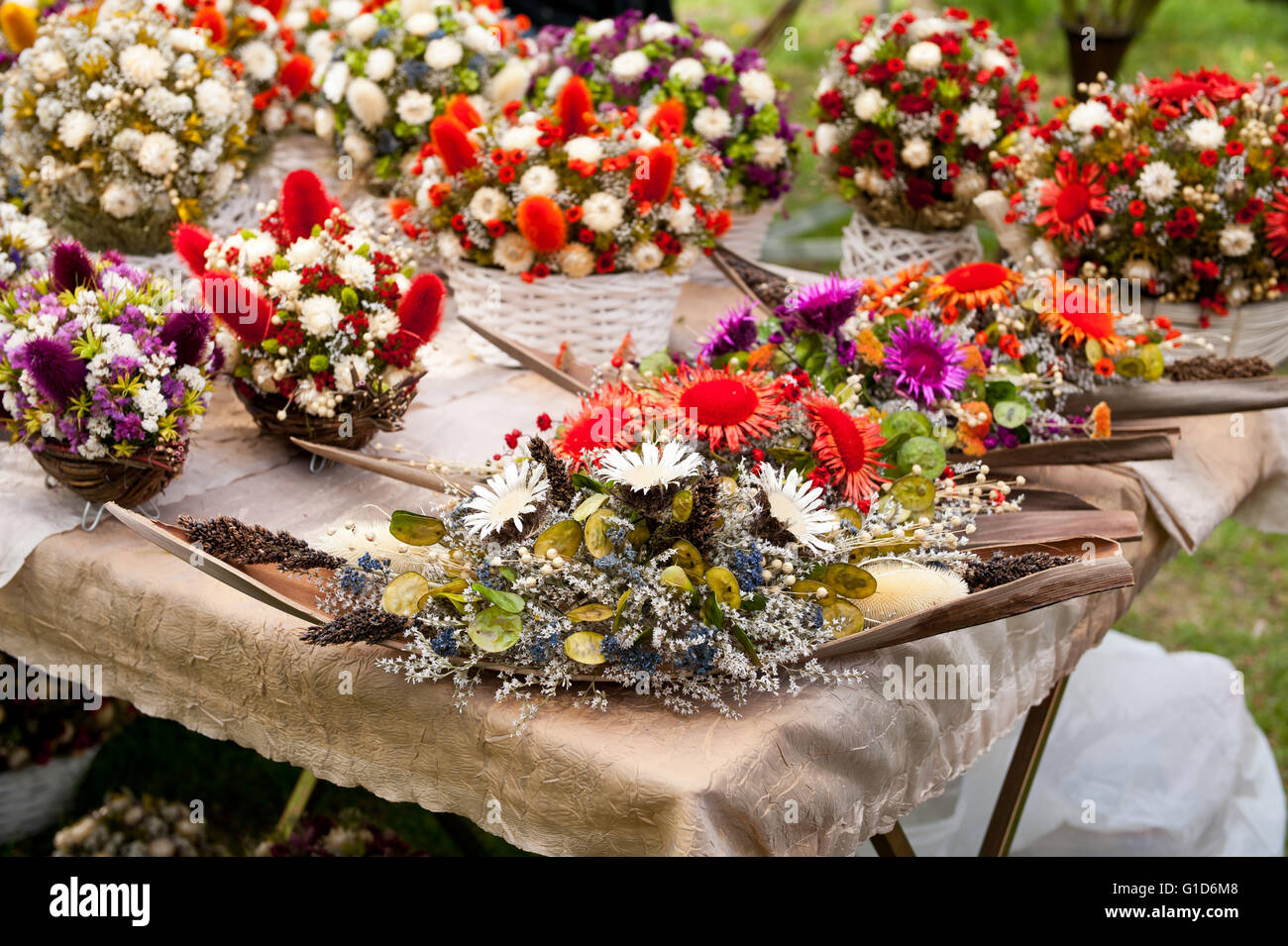 Dried flowers arrangements at fair on May day picnic in Janowiec Castle in Poland, Europe, leisure during Swedes - Stock Image