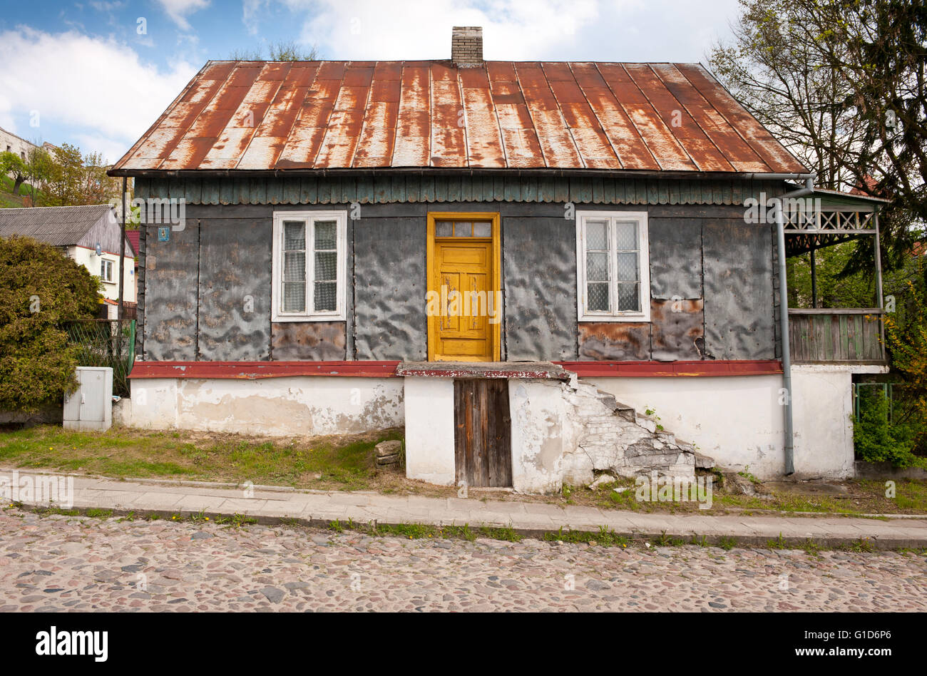 Old home in Janowiec village at Lubelska Street, dilapidated old weathered house, private property building exterior - Stock Image