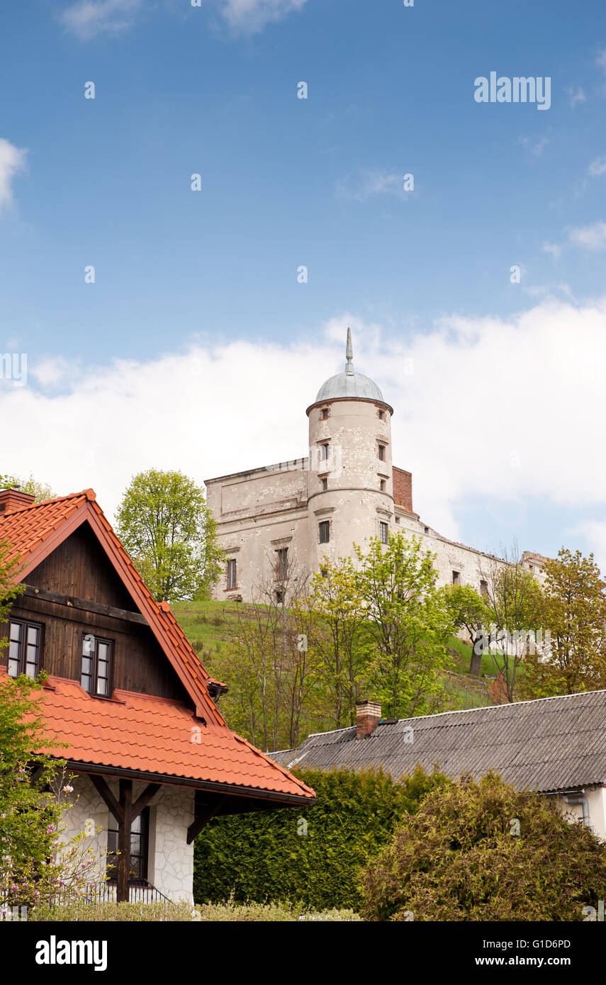 Historical Janowiec Castle exterior, building ruin on the hillside view from the Lubelska Street across houses, - Stock Image