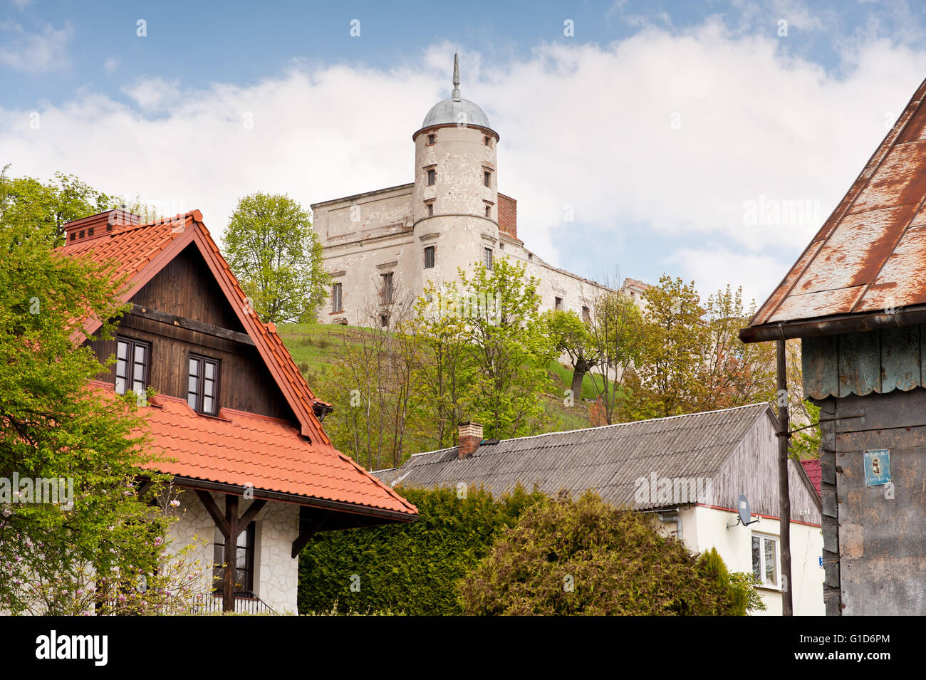 Janowiec Castle on the hillside, historical building ruin view from the Lubelska Street across houses, active leisure - Stock Image