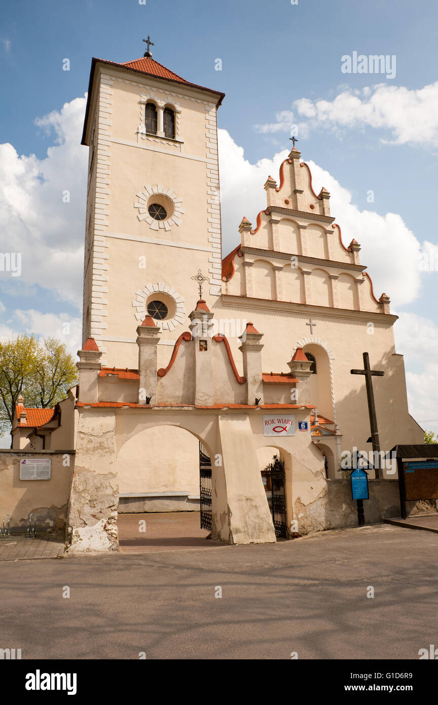 Church exterior in Janowiec village, Poland, Europe, front of Parafia pw. sw. Stanislawa i sw. Malgorzaty at Rynek - Stock Image