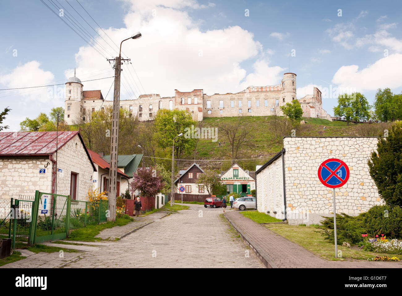 Castle ruins exterior in Janowiec, historical building on the hillside view across the Plac Wolnosci Street below, - Stock Image
