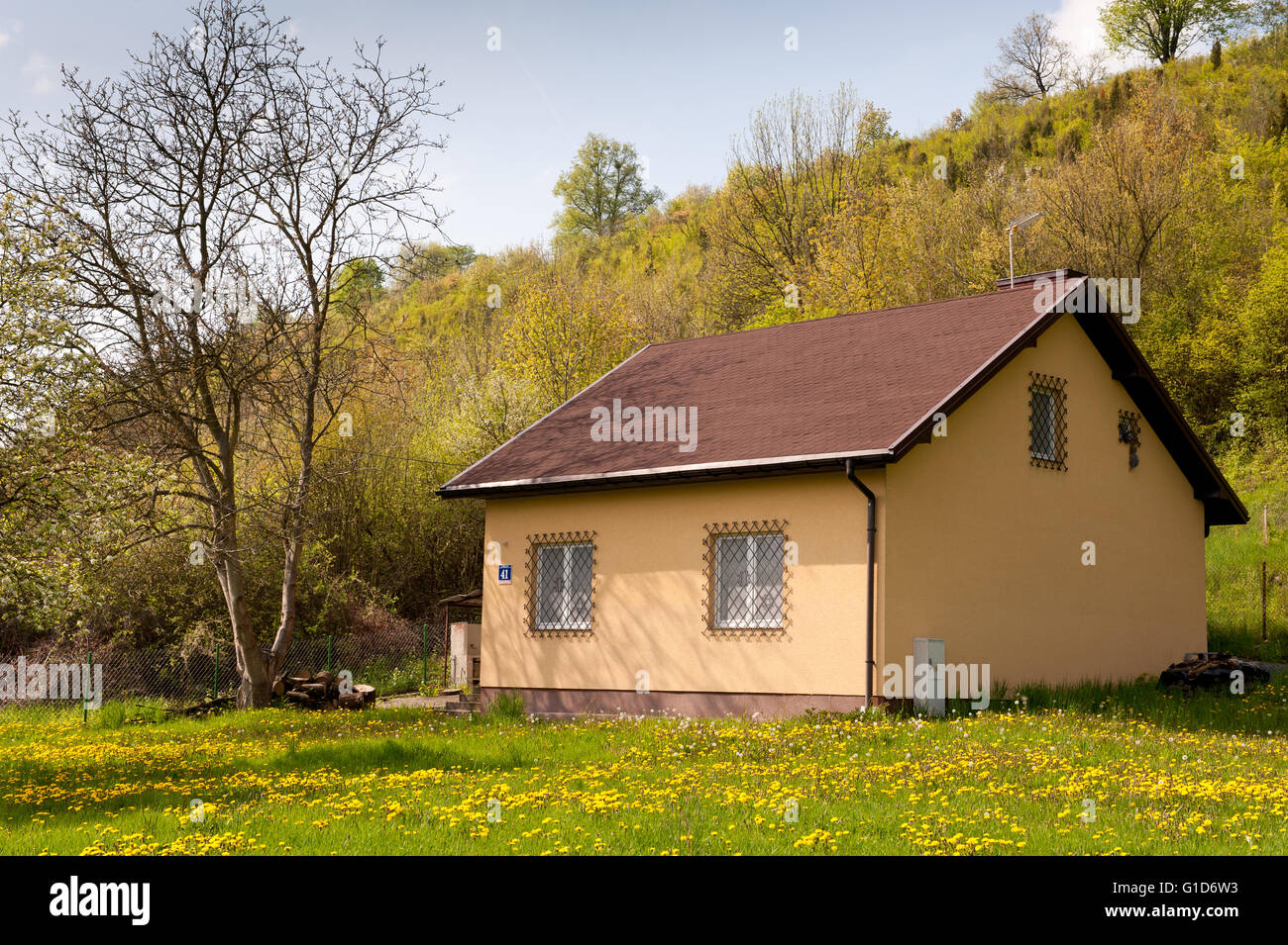 Little house building in spring natural landscape, house backyard below the hillside in Janowiec in Poland, Europe, - Stock Image