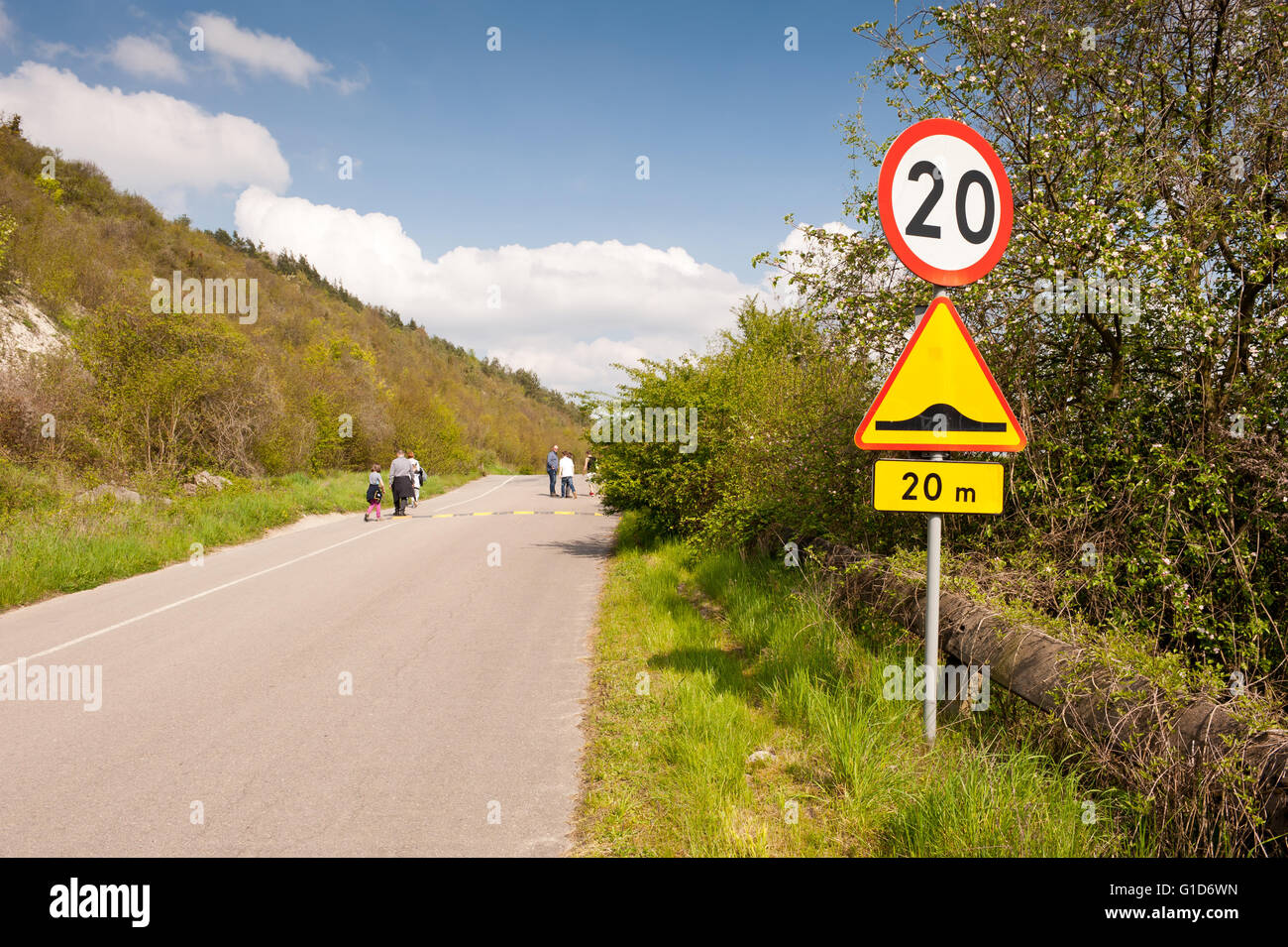 Speed bump and maximum limit of 20, road sign on the wayside in Janowiec village, speed humps traffic calming for - Stock Image
