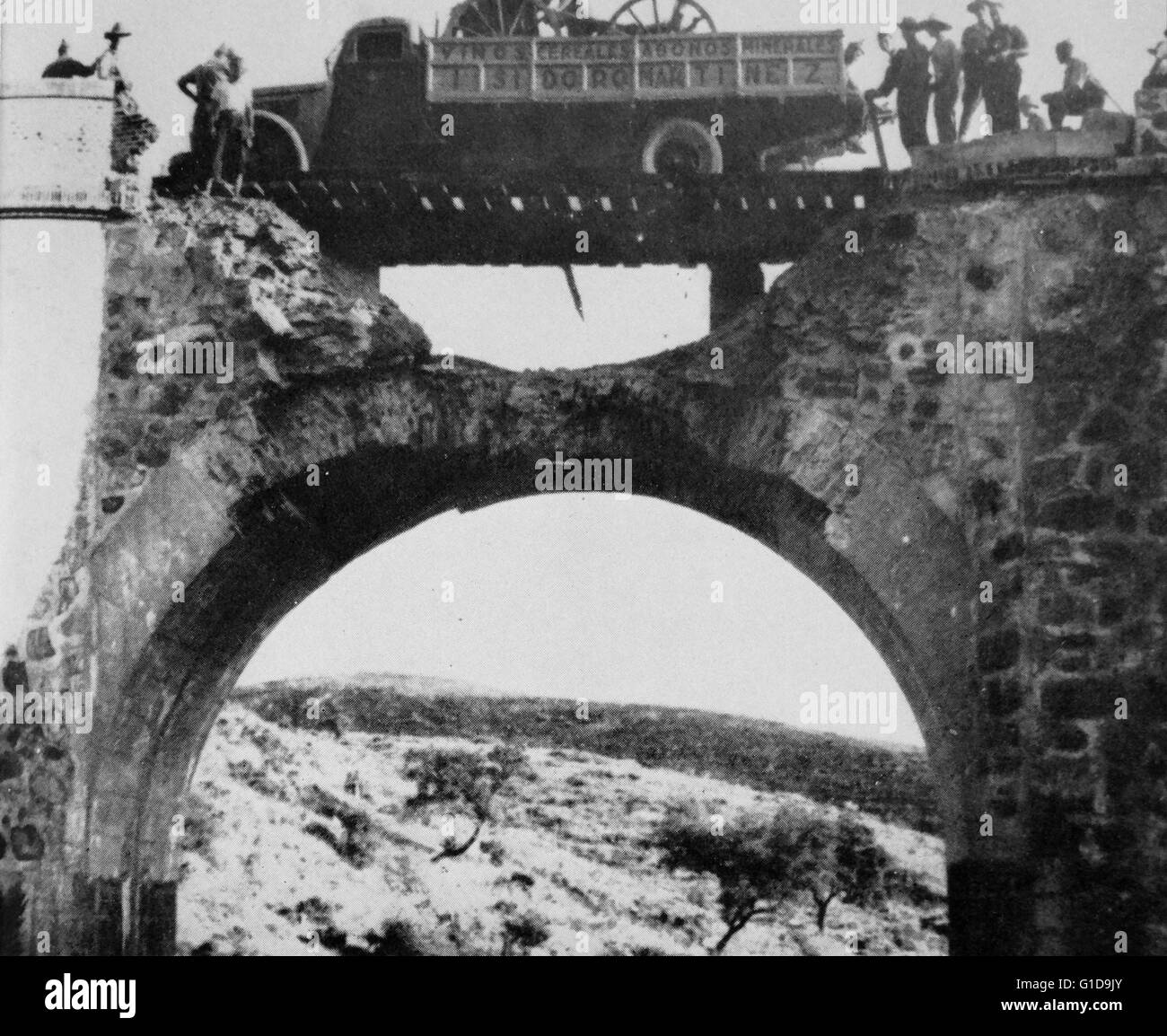Nationalist troops cross a badly damaged bridge during the Spanish Civil War 1936 - Stock Image
