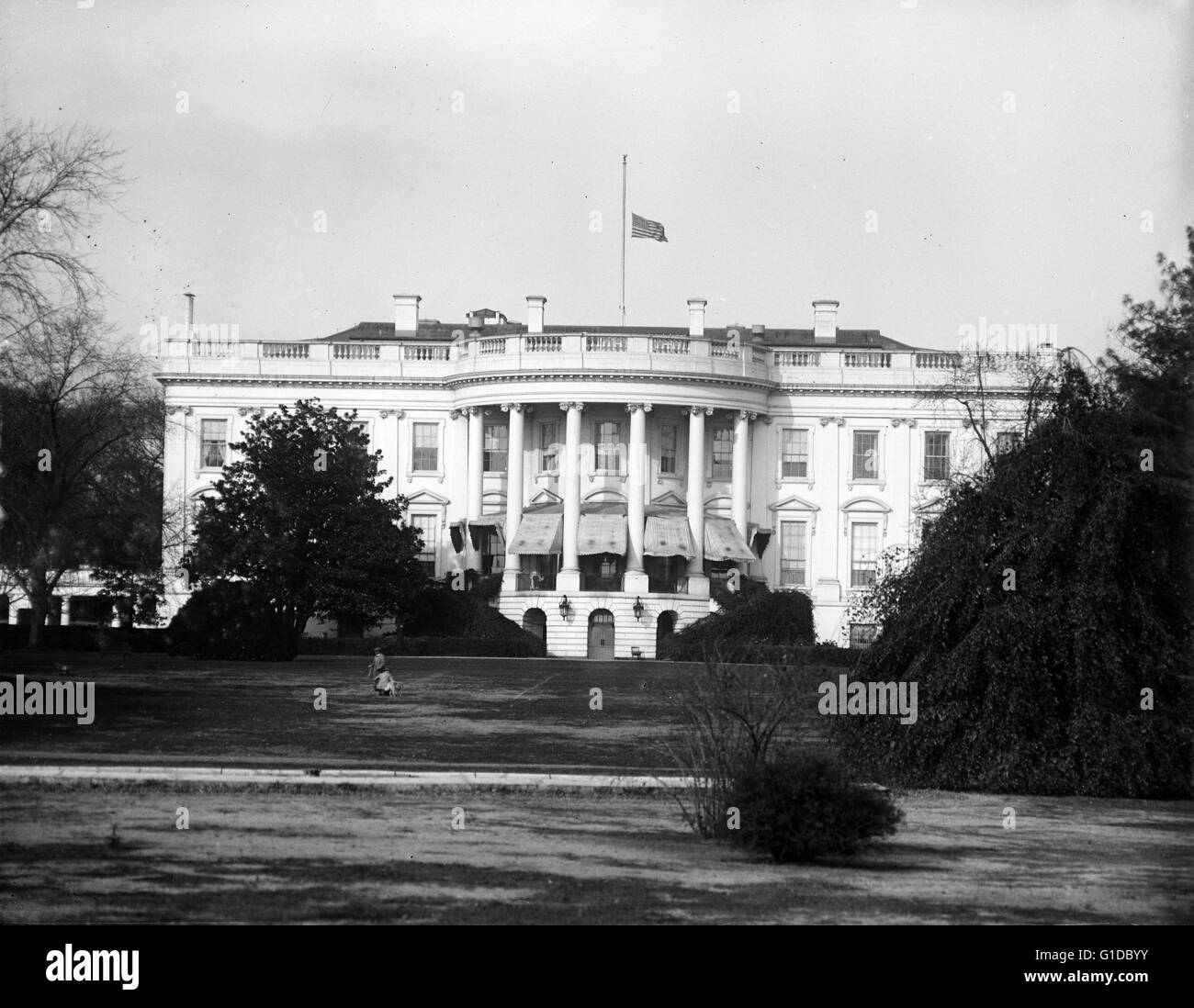 White House flag at half-mast. The flag on the White House is flown at half-mast except upon the occasion of the - Stock Image