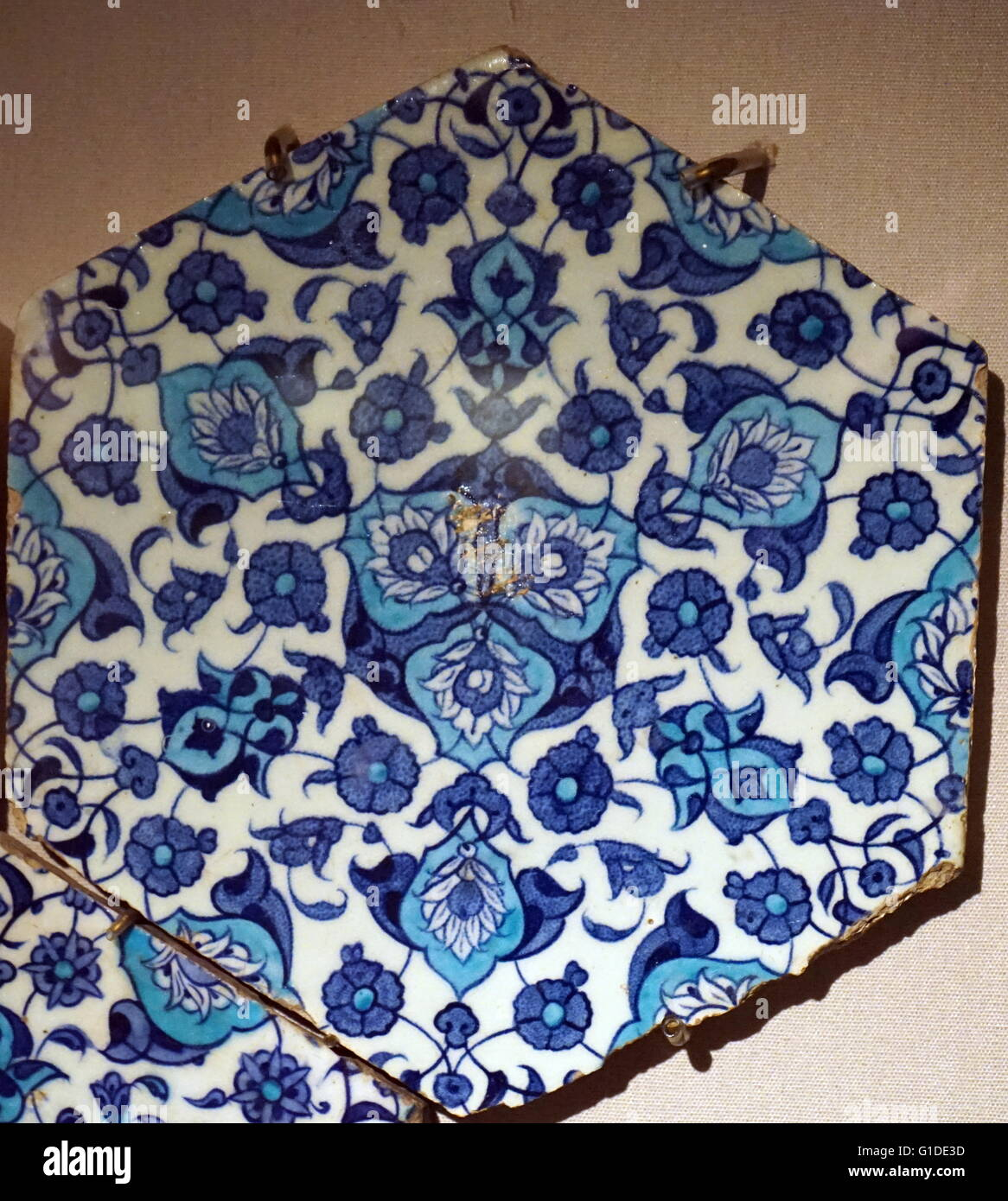Hexagonal tiles from a panel with arabesque medallion. Dated 16th Century - Stock Image