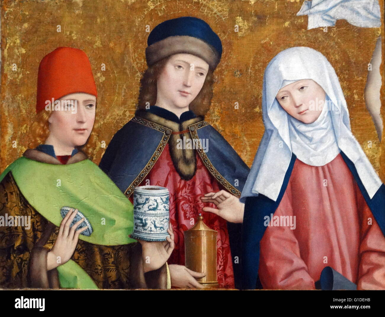 Painting titled 'Saints Cosmas and Damian and the Virgin' by Master of Liesborn, a Westphalian painter. - Stock Image