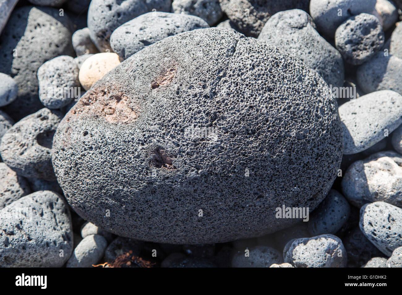 Large pumice stone rounded beach pebbles, Caleta de Caballo, Lanzarote, Canary islands, Spain - Stock Image
