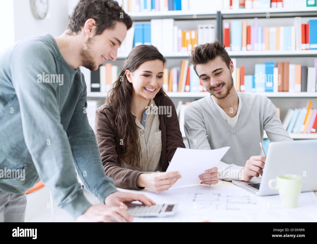 College students working together on a project, education and learning concept - Stock Image