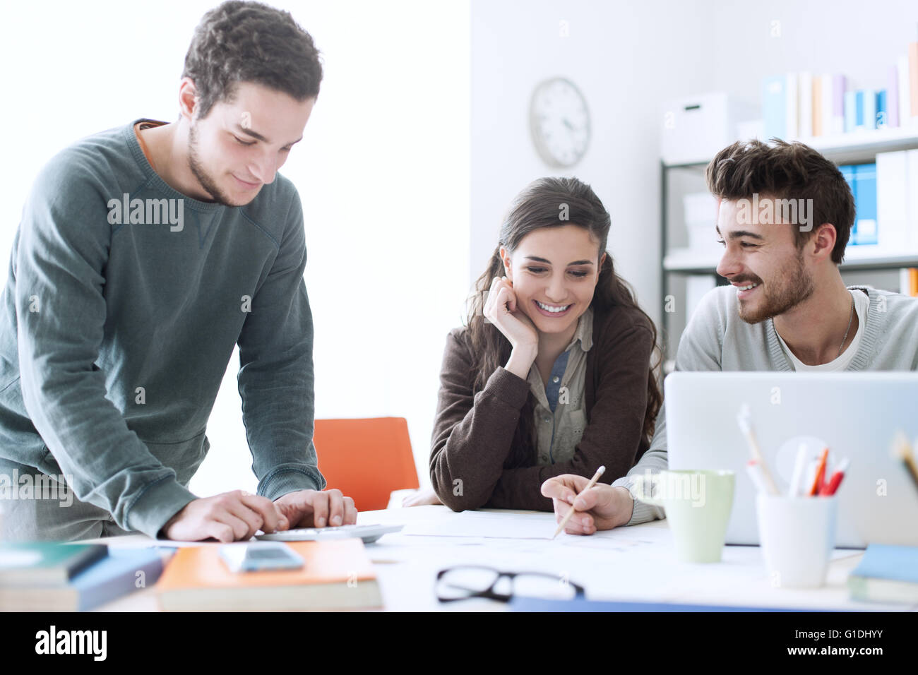 Young college students working on a design project, education and creativity concept - Stock Image