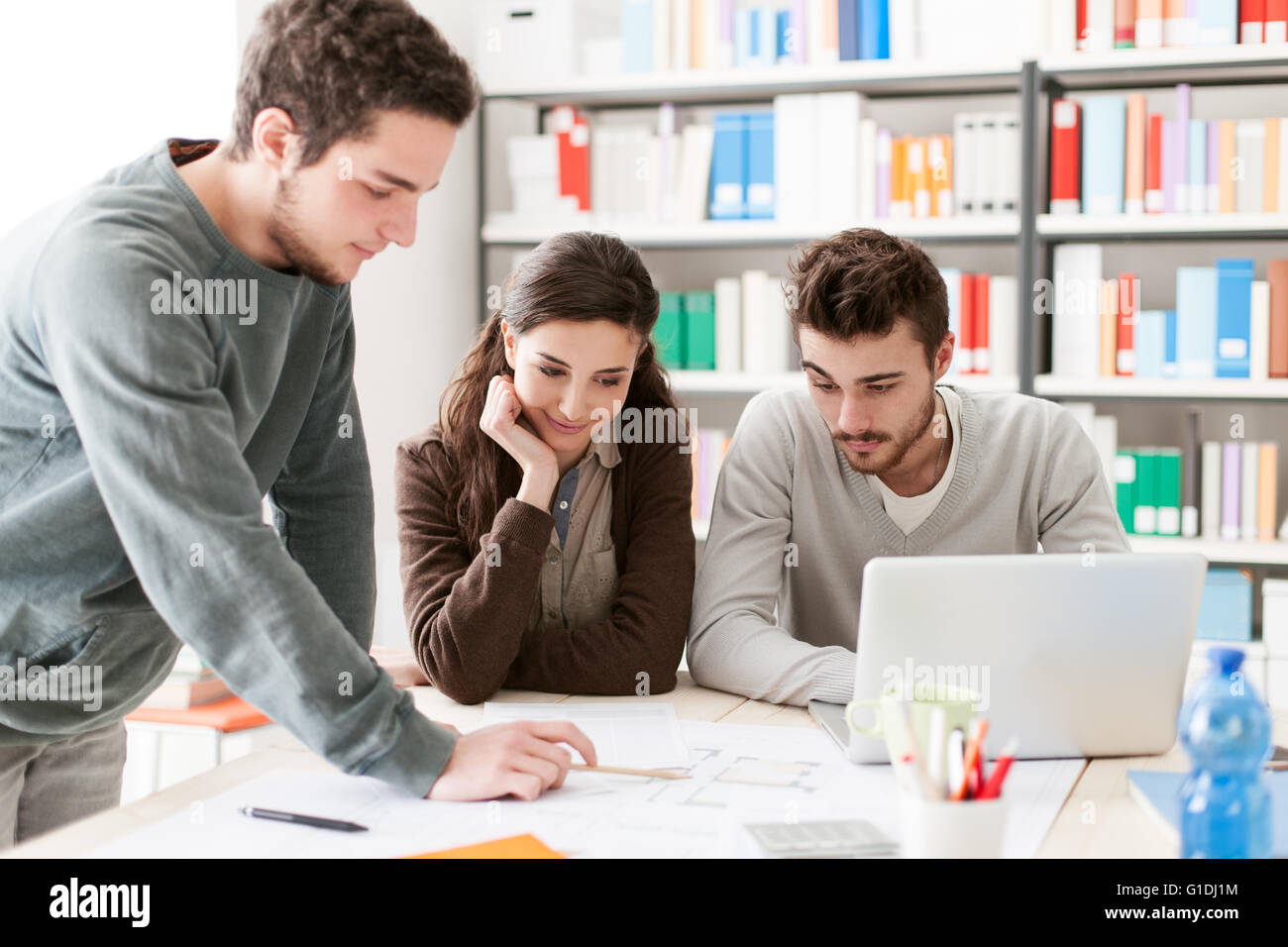 College students working together on a design project, education and learning concept - Stock Image