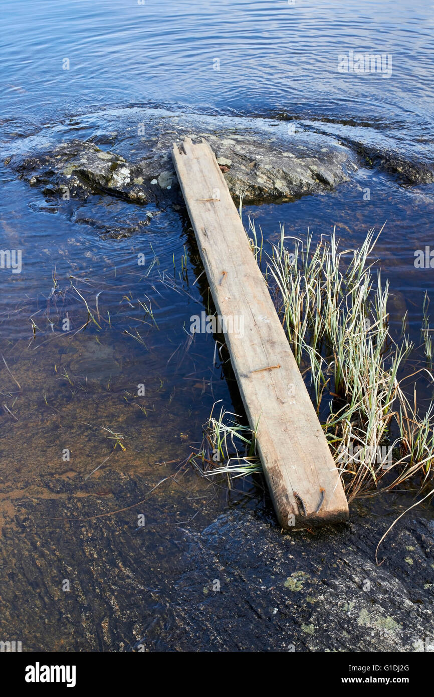a plank over the water - Stock Image