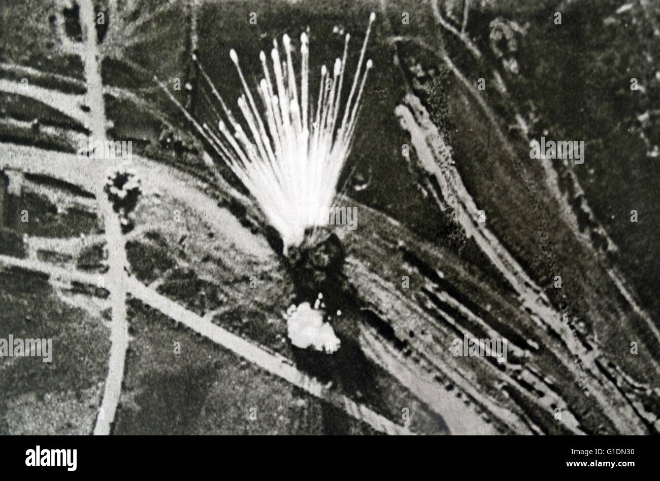 Photograph shows the explosive aftermath of an ammunition train during The Great War. Dated 20th Century - Stock Image
