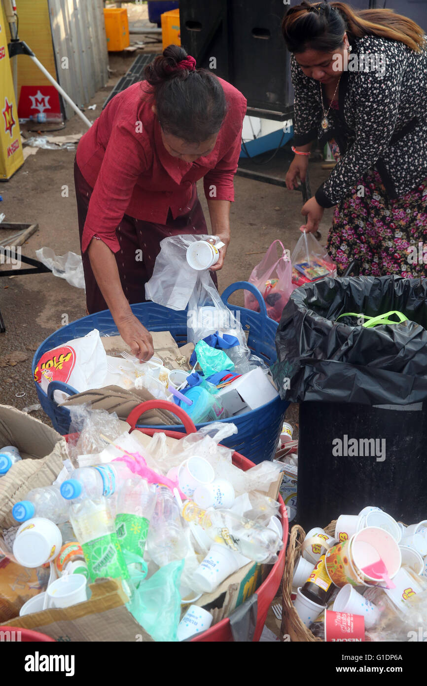 Two women scavenge for things to recycle.  Vientiane. Laos. - Stock Image