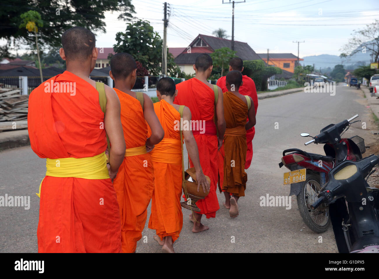 Monks going round for alms.  Vang Vieng. Laos. - Stock Image