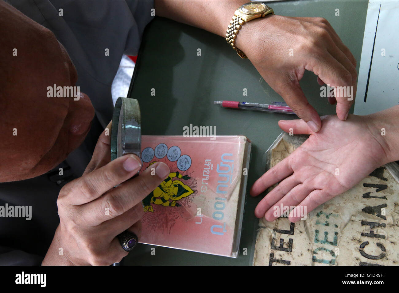 Fortune teller at Wat Pho Temple.  Bangkok. Thailand. - Stock Image