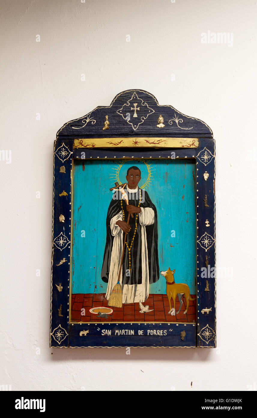 Painting on wood of San Martin de Porres, patron saint of mixed-race people. - Stock Image