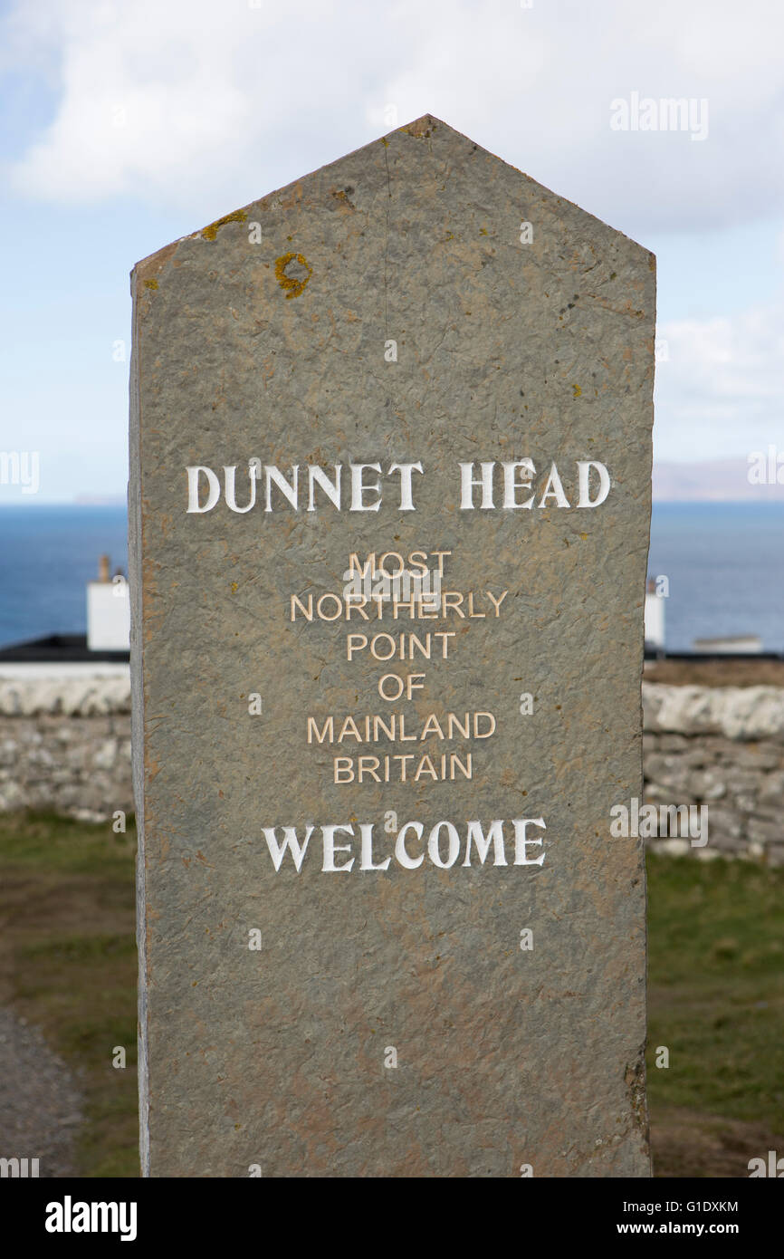 Dunnet head sign and lighthouse - Stock Image
