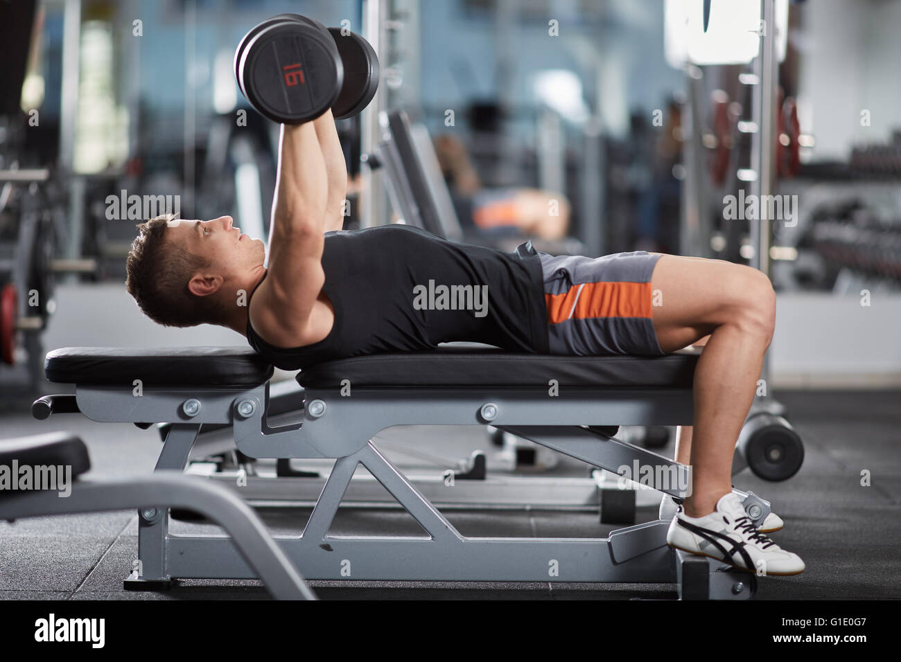 Man Doing Chest Workout Bench Press With Dumbbells