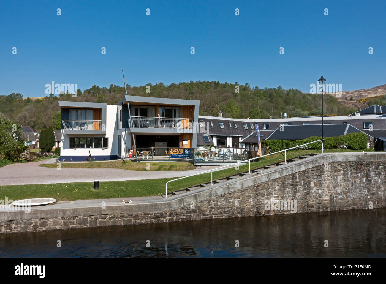 New Moorings Hotel café complex facing Neptune's Staircase at the Caledonian Canal  Banavie near Fort William - Stock Image