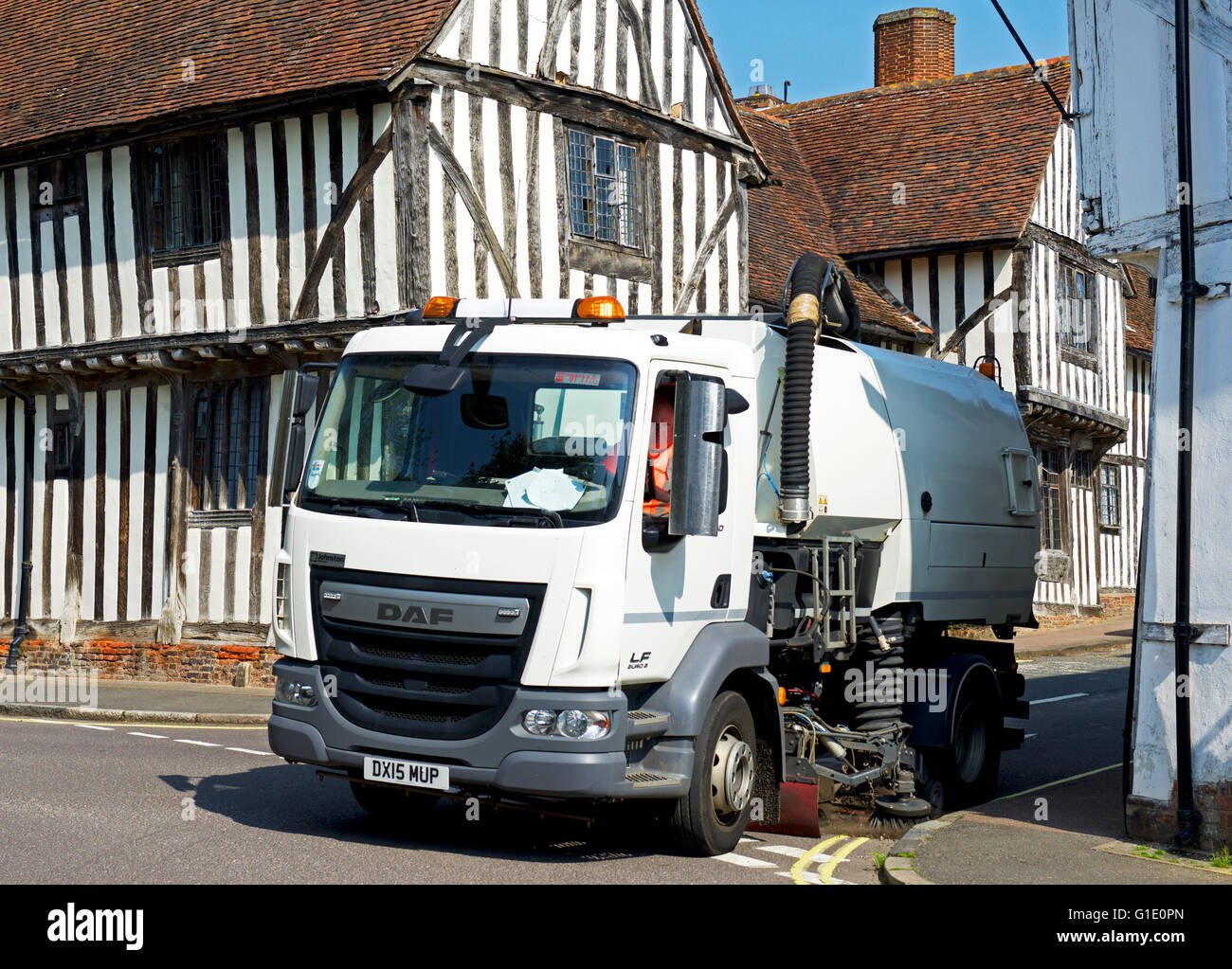 Street-sweeping vehicle in the village of Lavenham, Suffolk, England UK - Stock Image