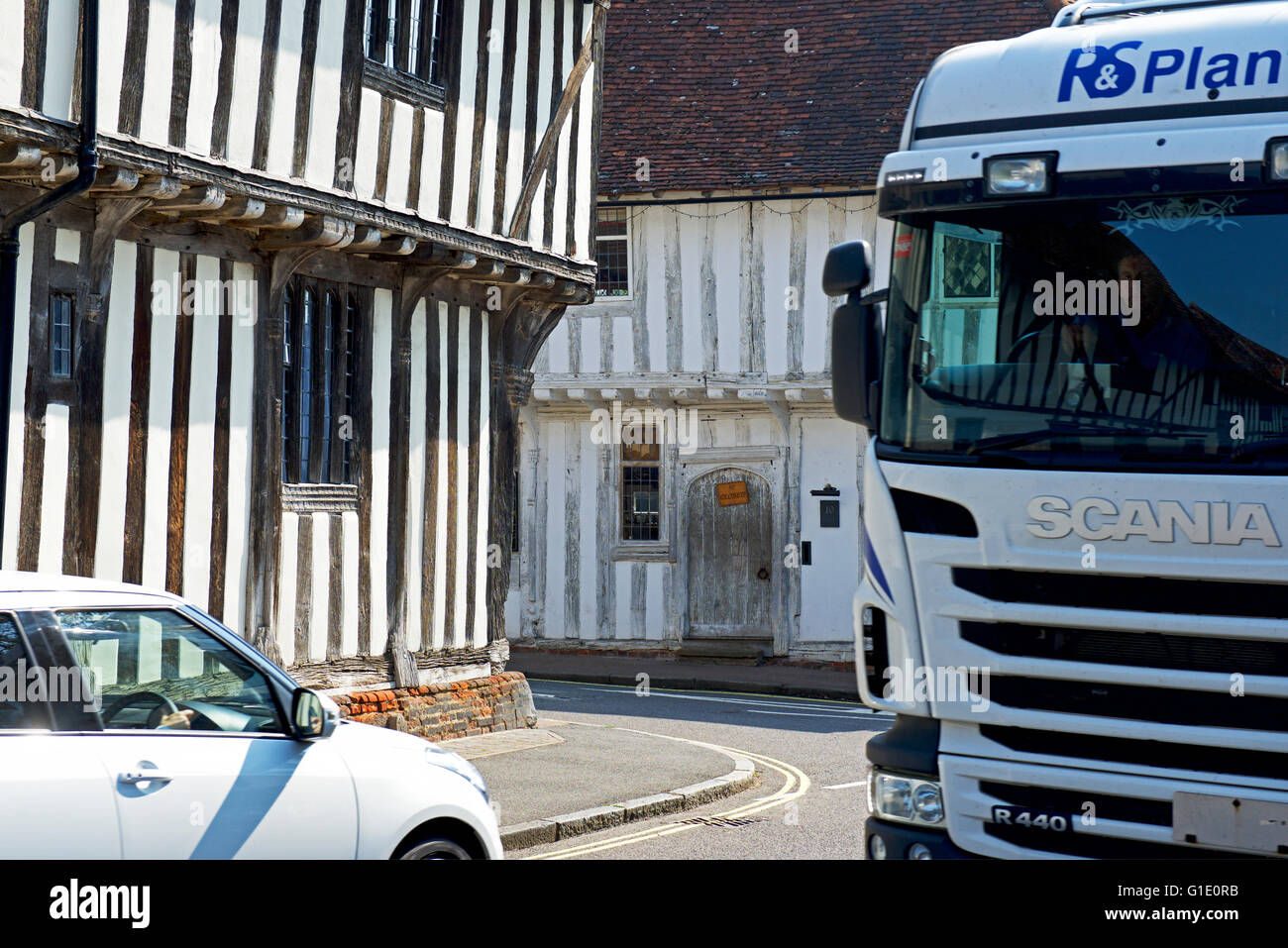 Car and lorry in the village of Lavenham, Suffolk, England UK - Stock Image