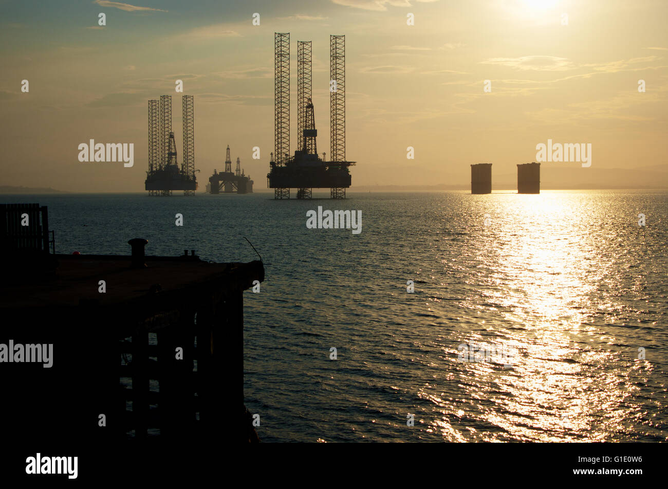 Oil rigs parked in Cromarty Firth, Scotland - Stock Image