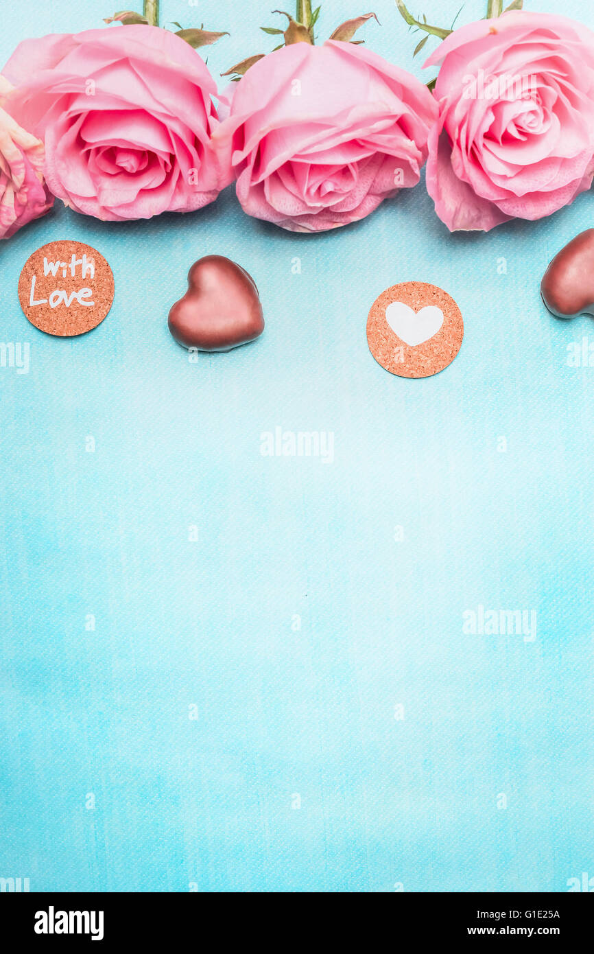 Pink Roses With Heart Chocolate And Romantic Love Message On Blue