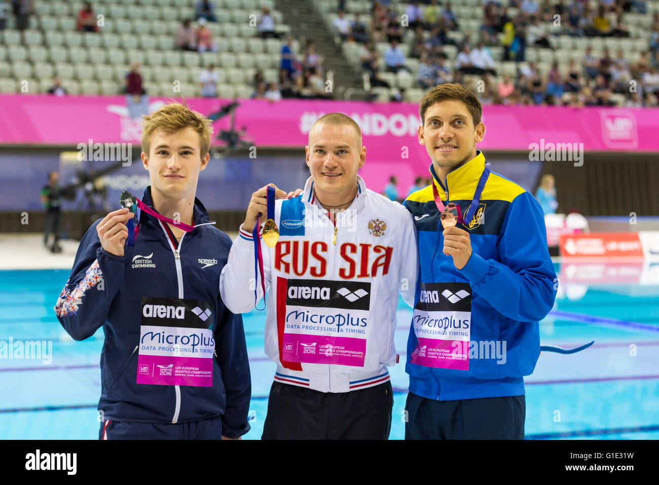 Aquatics Centre, Olympic Park, London, UK. 12th May 2016. The three medallists. Russia's Evgeny Cuznetsov takes - Stock Image