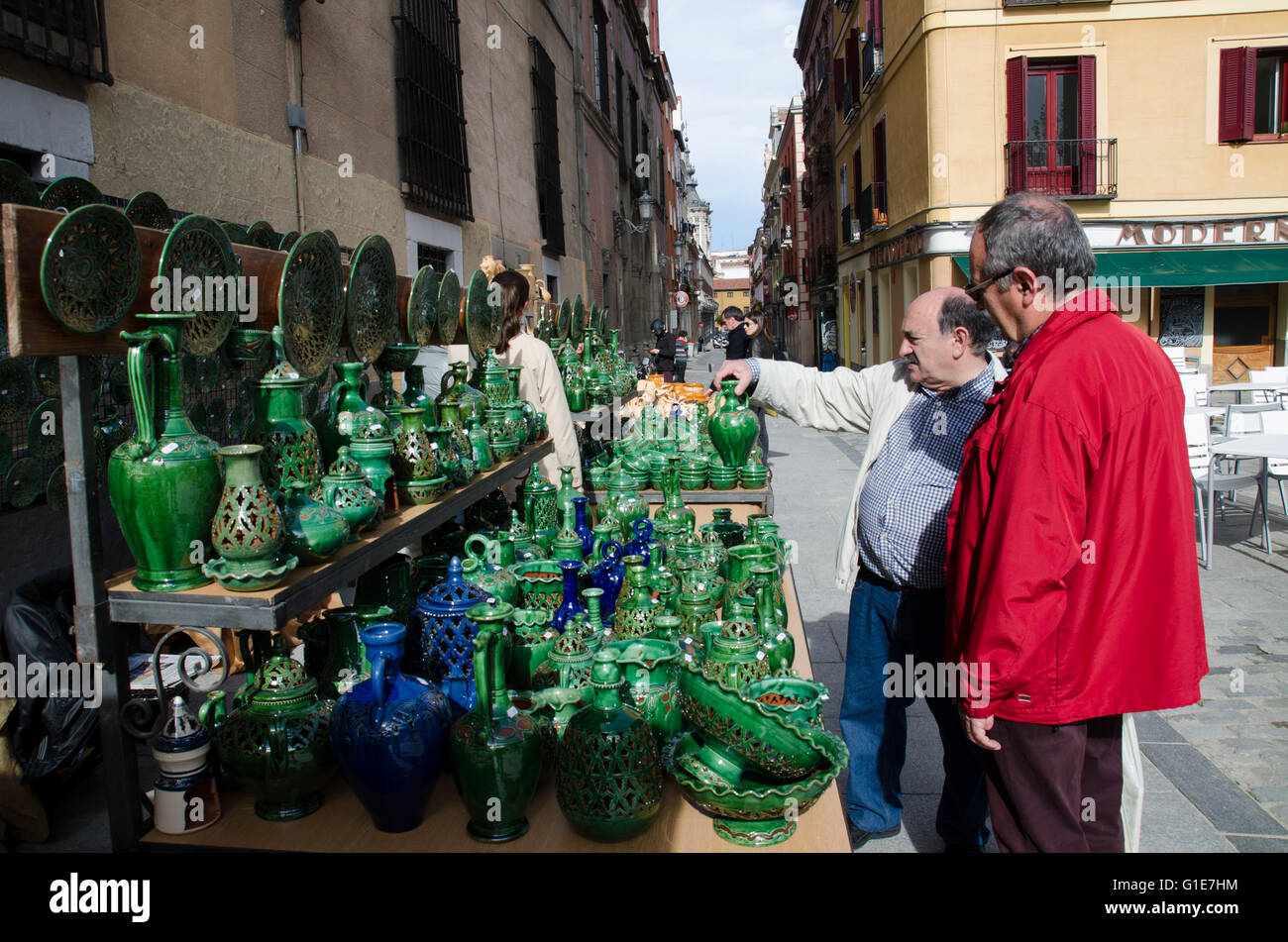 Madrid, Spain. 13th May, 2016. Two men inspecting a jar with a green vitreous enamel made by the potter 'Gongora' - Stock Image