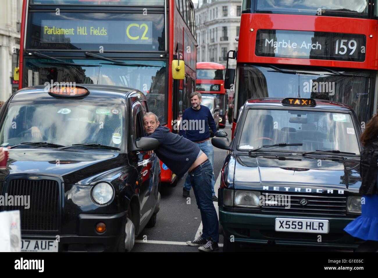 London, UK. 14th May 2016. Cabbies relax as they wait for the march to progress. Credit: Marc Ward/Alamy Live News Stock Photo