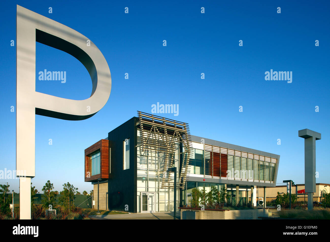 Martin Luther King Jr. Transit Center, Compton, CA by Base Architecture. Close view of a large metal P. - Stock Image