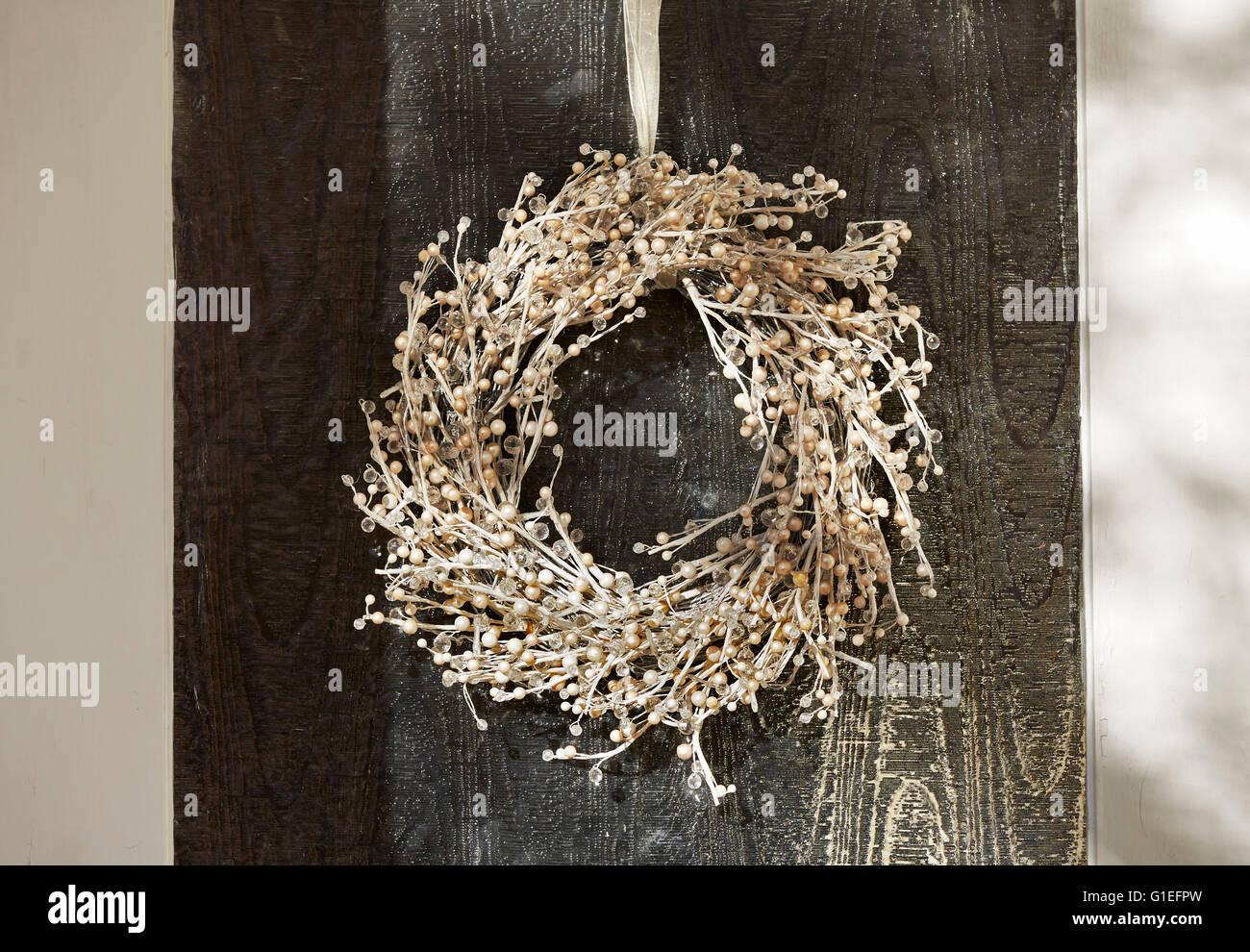 Christmas Garland on Door. Garland hanging on the door. - Stock Image