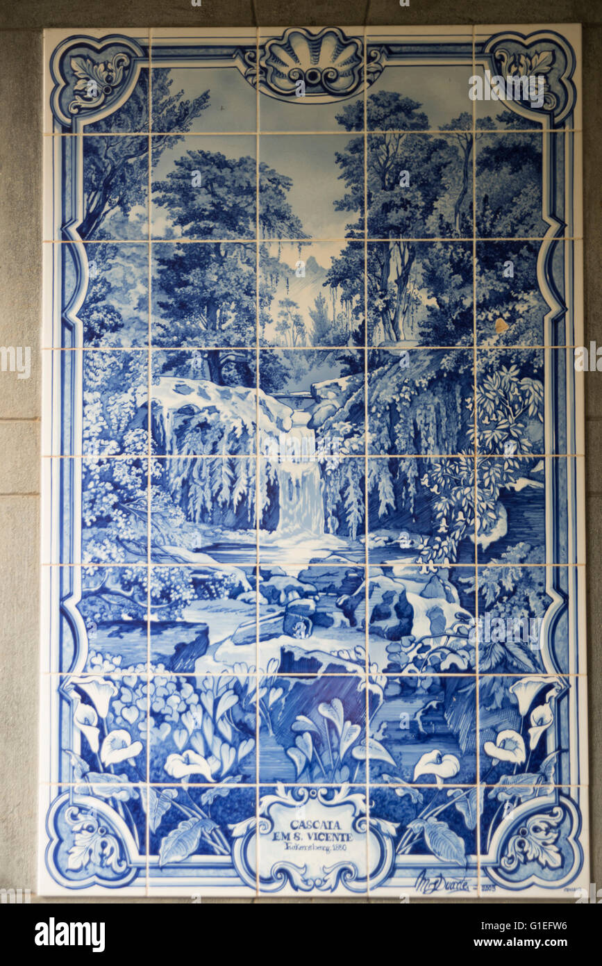 Historic azulejos (tiles) at the Grutas (Caves) de Sao Vicente, Madeira, Portugal. Blue and white ceramic tile. - Stock Image